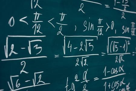 Mathematics formulas written on the blackboard. School, education. Imagens