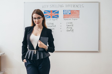 Female teacher in classroom English language school. Stock Photo - 113206250