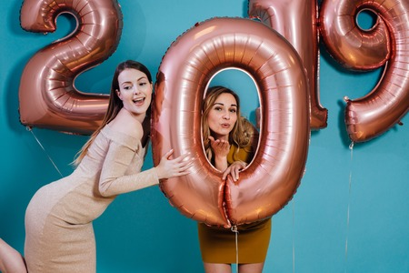 Happy new year and Merry Christmas Beautiful young women with balloons.