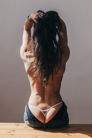 Back view of naked back young woman Stock Photo