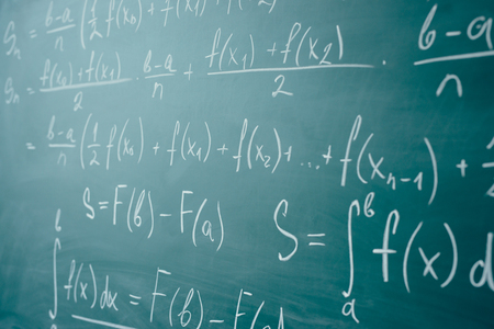 Math class. Algebra. The formulas are written on the school board Stock Photo