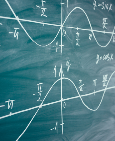 Math lesson. Sine and cosine functions. Graphics graphics drawn on the Board Stock Photo