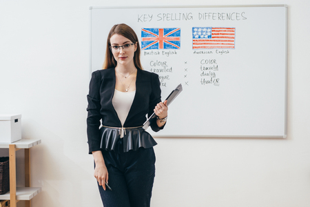 Female teacher looking at camera. English language school. Stockfoto