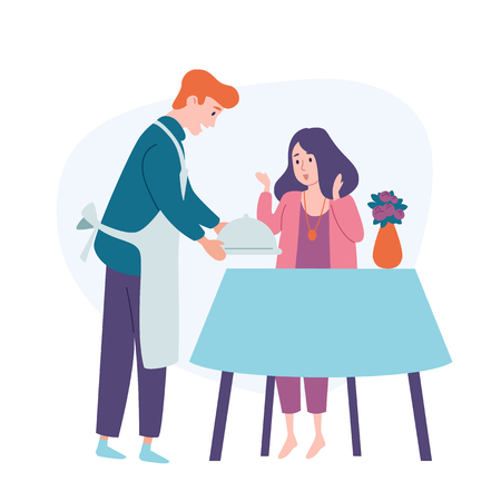 Man serve table, bring food to his wife Husband feeding woman. Family couple Festive meal holiday dinner