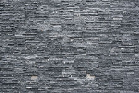 Slate stone wall background texture Decorative masonry Stock Photo - 124527638