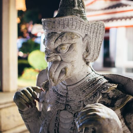 Statue, sculpture at Wat Arun Temple. Bangkok, Thailand. Banco de Imagens