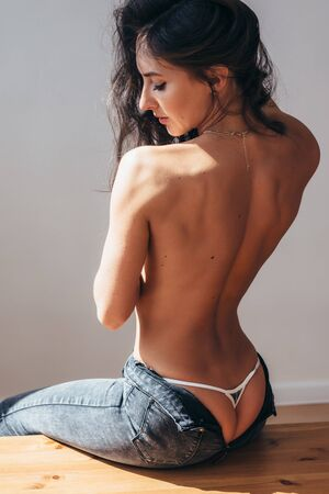 Back view of naked back young woman Banco de Imagens