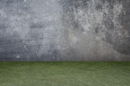 Concrete wall and green grass texture background. Zdjęcie Seryjne