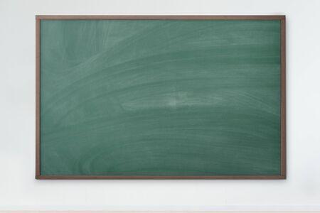 Blackboard Empty green chalkboard with chalk traces. texture background.
