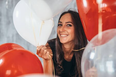 Beautiful woman posing with balloons Holiday, celebration