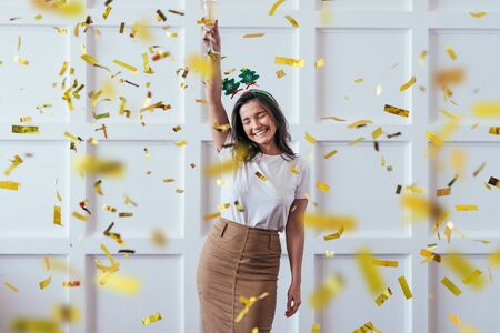 Portrait of young woman with glass celebrate Christmas or New Year Imagens - 133998167