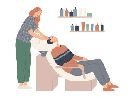 The hairdresser washes her client s hair in preparation for the haircut