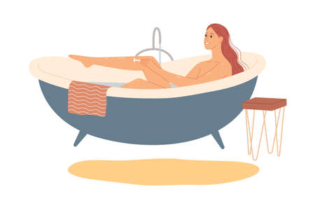 Woman in the bath shaves her legs