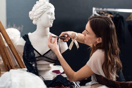 Female lingerie designer working on a bra Stock fotó