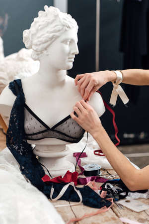 Female lingerie designer working on a bra