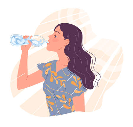 Young woman is thirsty in the heat and drinks water