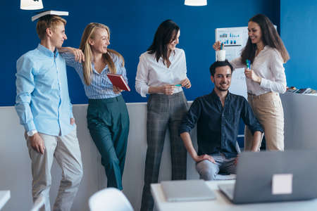 Group of young people having fun in a office Standard-Bild