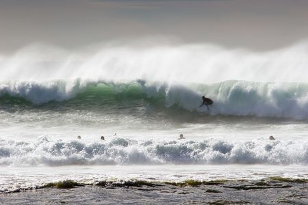 Surfing the break at Haumoana Beach, Hawkes Bay, New Zealand Stock Photo