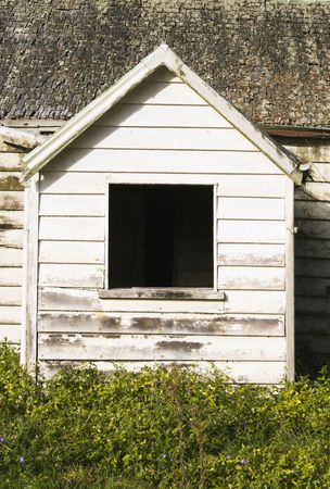 aotearoa: Old house with an old window frame in an old neck of the woods Stock Photo