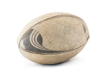 A well used and worn rugby ball isolated on white