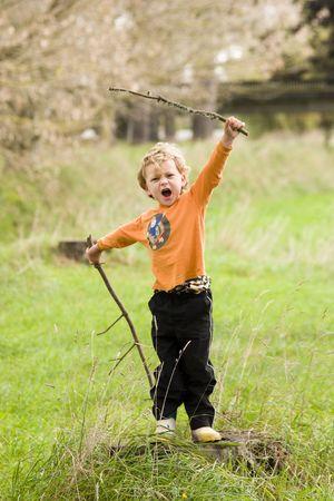 aotearoa: young caucasian boy playing as a warrior