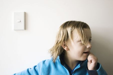 The boy and the lightswitch were inseperable - the best of buddies Stock Photo