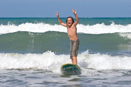 A young caucasian male learns to surf on Whangaehu Beach, Central Hawkes Bay, New Zealand photo