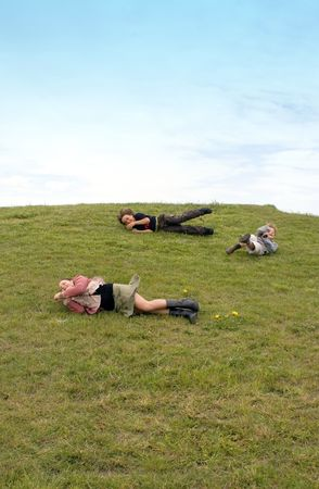kids having fun rolling down a grassy hill Stock Photo - 2571843