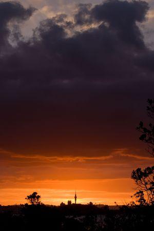 aotearoa: Auckland City with the iconic Sky Tower at Sunset. Viewed from Rangitoto Island, Hauraki Gulf, New Zealand. Stock Photo