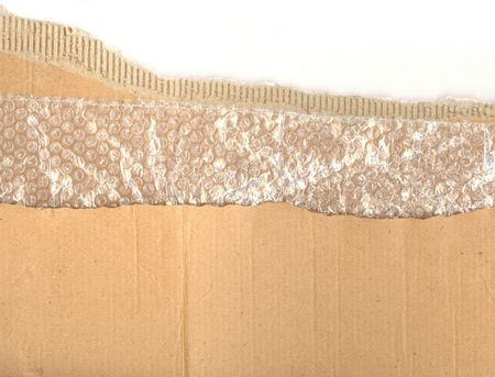 Ripped pieces of corrugated cardboard and bubblewrap ready for you to use your design skills on
