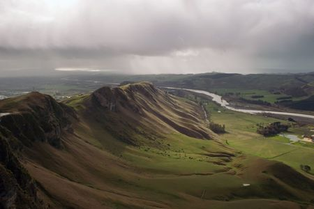 Te: A rainy winters day in Hawkes Bay, New Zealand. View from the top of Te Mata Peak looking down Tuki Tuki River towards the coast