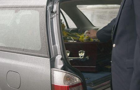 casket: Casket at a funeral Stock Photo