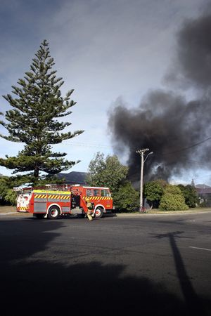 Firemen attending a house fire in Haumoana, New Zealand photo