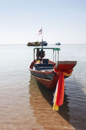 snorkelling: Longtail boat at Mango Bay, Koh Tao Island, Thailand - a popular place for diving and snorkelling