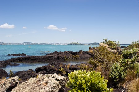 The view from Rangitoto Island in the Hauraki Gulf, New Zealand. Auckland City in the background. Stock Photo