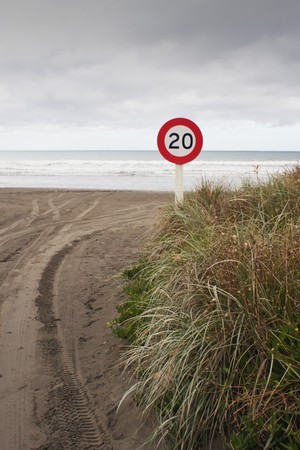 tred: A speed sign at the road access to Kapiti Beach, Wellington, New Zealand