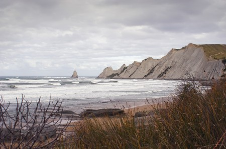 Cape Kidnappers is one of the largest mainland gannet colonies in the world. Cape Kidnappers is a 13 hectare reserve that includes the Saddle and Black Reef gannet colonies. It is located 15km east of Hastings, Hawkes Bay, New Zealand Stock Photo