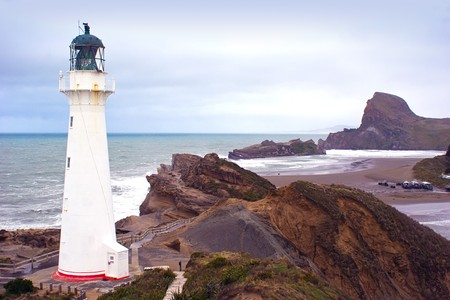 The lighthouse at Castlepoint in the Wairarapa coast, New Zealand photo