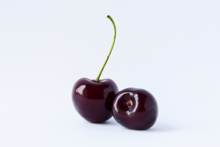 Two cherries isolated on a white background Stock Photo