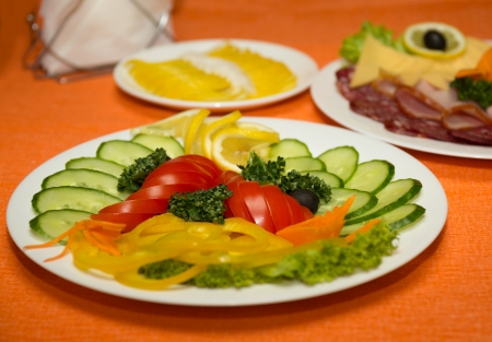 Vegetable assortment on a dish on a orange background Stock Photo