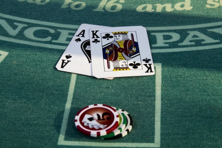 Close up on a players Blackjack hand  The player has a King and Ace of Spades with a bet of  30 in chips 版權商用圖片 - 22916522