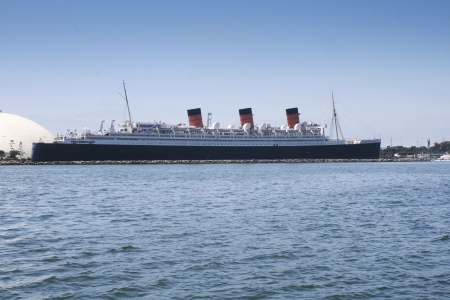 Queen Mary with the bay in the foreground during a bright summer day