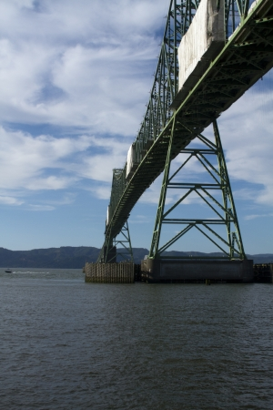 The Astoria-Megler Bridge under repair spanning over the Columbia River with Washington in the background