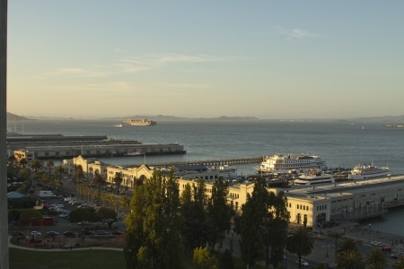 Overlooking the San Francisco Bay near pier 3 with a Cargo ship in the distance