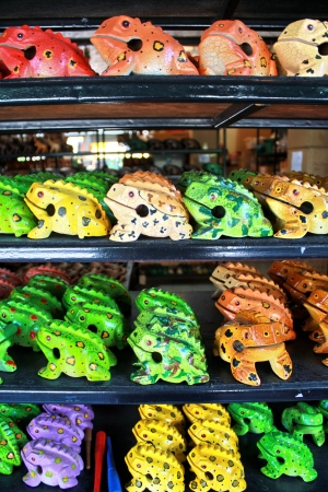 Colorful hand carved wooden frog standing on shelves Stock Photo - 16596860