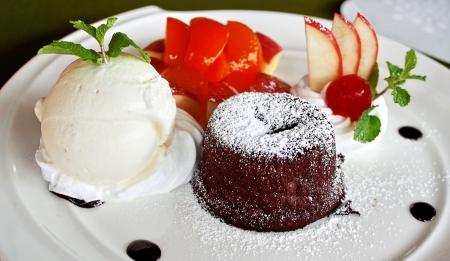 lava chocolate cake with fruit salad and ice cream  photo