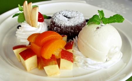 fruit salad with ice cream and warm lava chocolate photo