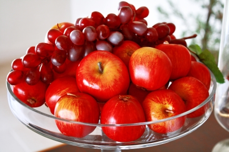 fresh apple and red grape on glass plate photo