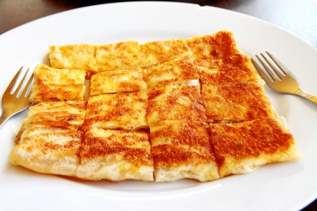 crispy pancake named  roti ,fried bread with butter and egg photo