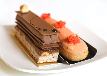 A piece opera chocolate cake and Thai tea eclairs photo